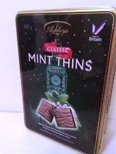 EXQUISITE PEPPERMINT FLAVOURED CENTRES COVERED IN SMOOTH CHOCOLATE FLAVOUR SHELLS ASHLEYS CLASSIC MINTH THINS IN A BEAUTIFUL COLLECTABLE REUSABLE TIN GIFT BOX 300 GRAMS MADE IN BRITAIN CHOCOLATE FLAVOUR THINS WITH A MINT TRUFFLE FILLING from ASHLEYS