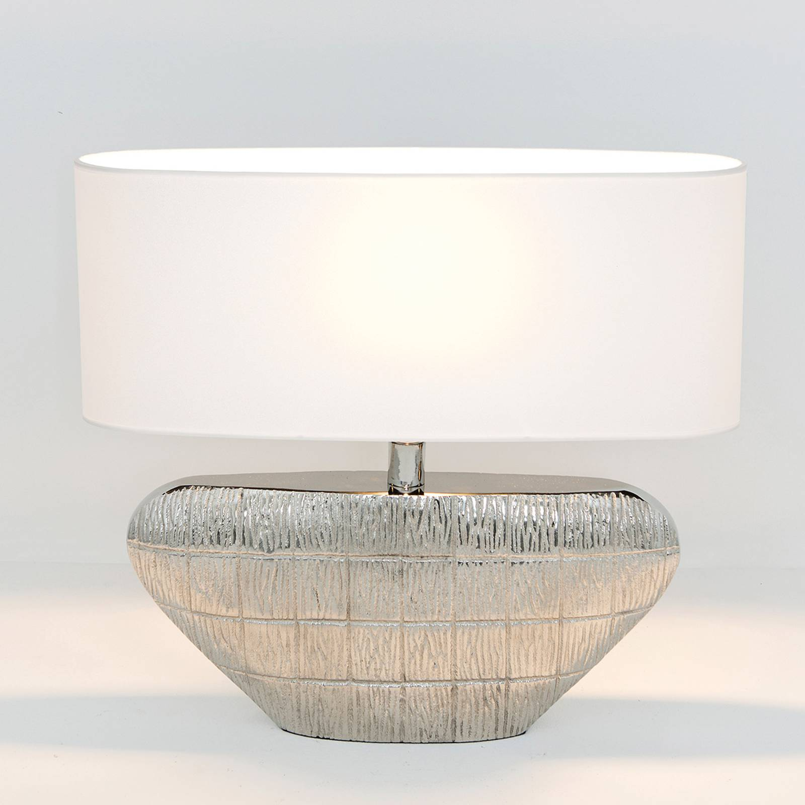 Cleopatra oval table lamp with a fabric lampshade from J. Holländer