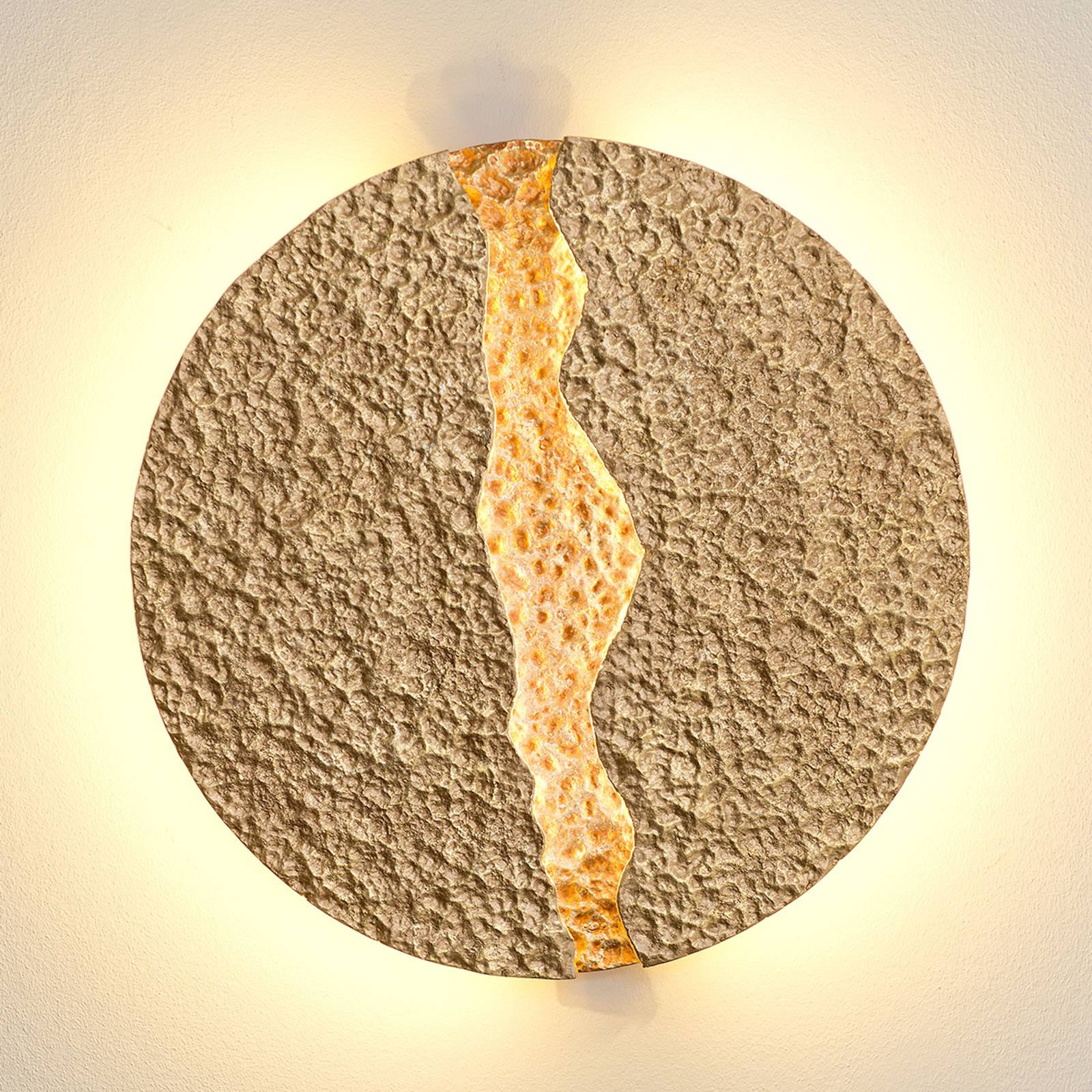 Eruption - round, gold-coloured LED wall light from J. Holländer