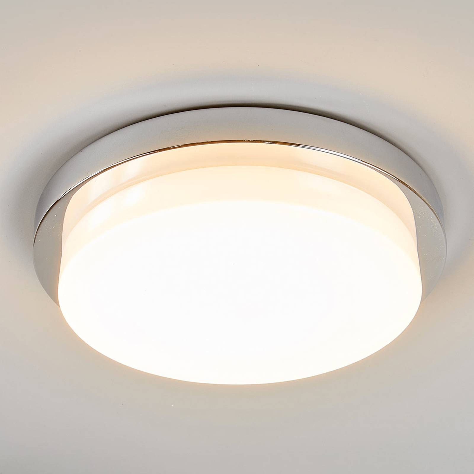 Glossy chrome LED ceiling light Cordula, IP44 from Lindby
